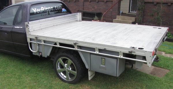Products on this flat top, 30 litre water tank with stainless steel straps, Mudguards and Ute Tool Boxes